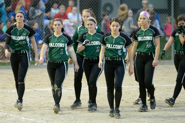Photo by Dan Hockett Lady Falcons walk off field after a 3-1 loss to West Liberty in the first round of Region play Wednesday night at West Liberty. From left: Kori Mesecher, Riley Hale, Jayla Kreiss, Kelci Hill, Courtney Coffin, Reagan Rogerson, Machaela Diaz.