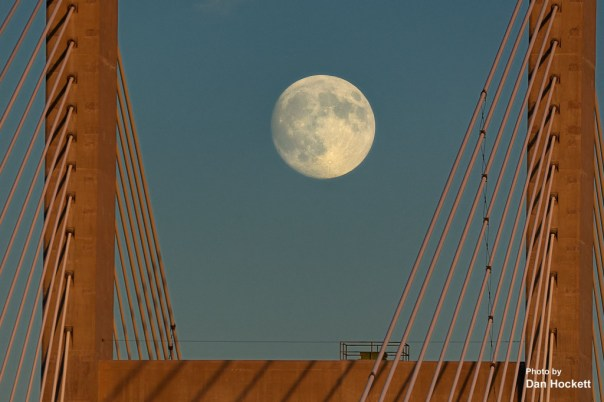 Photo by Dan Hockett A Super Moon appears between the towers of the Great River Bridge in Burlington Saturday night. A Full Super Moon and Lunar Eclipse will appear Sunday night starting at 7:11 p.m. and peaking at 9:47 p.m. A Super Moon is at its perigee and is 31,000-miles closer to earth than during the apogee of its orbit. The Super Moon will appear 14% larger and 30% brighter in the night sky.