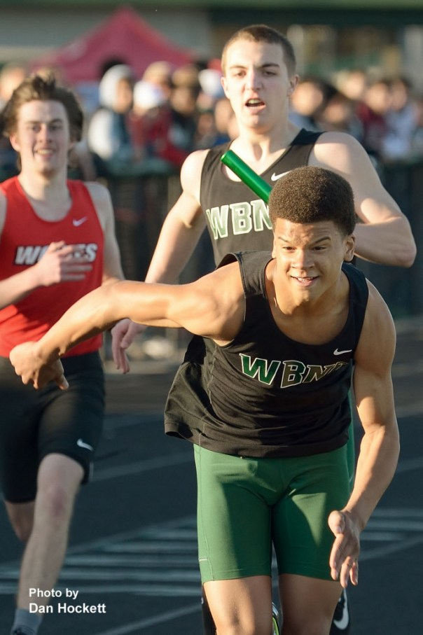 Photo by Dan Hockett West Burlington – Notre Dame's Rel Greer is ready to take the baton from Drake Day in the 4x200 relay at the Falcon Relays in West Burlington Monday.