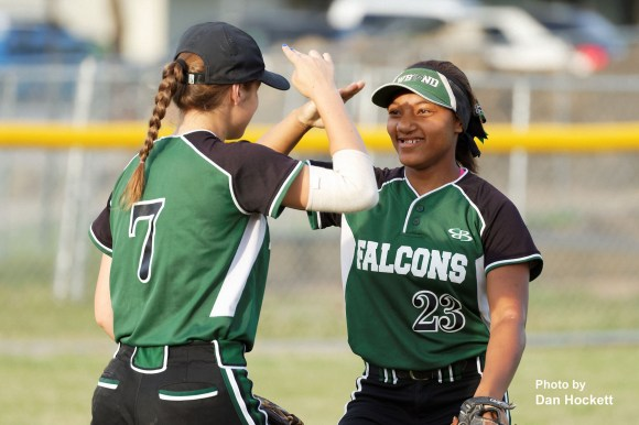 Photo by Dan Hockett West Burlington – Notre Dame Outfielders Jashira Baylark (23) and Adriana Moad salute to start the inning against Mediapolis makes a running catch against Mediapolis Monday night in West Burlington. Mediapolis defeated West Burlington – Notre Dame, 11-0.