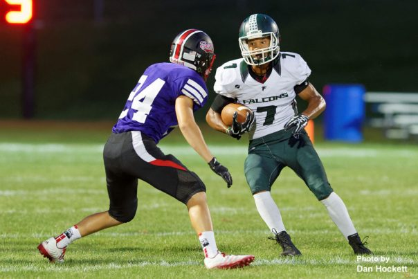 Photo by Dan Hockett West Burlington – Notre Dame's Rel Greer (7) carries the ball against West Branch Friday night in West Branch. WBND defeated No. 2 (1A) West Branch, 27-18.