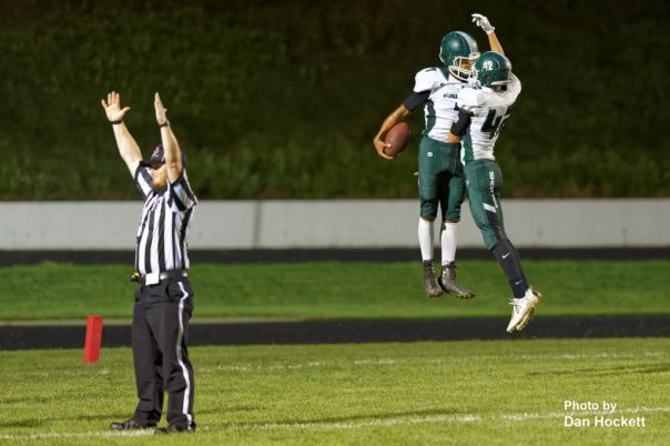 Photo by Dan Hockett West Burlington – Notre Dame Wide Receiver Rel Greer (with ball) is congratulated by teammate Reece Richards (42) after scoring on a 51-yard pass in the second quarter against Fairfield Friday night in Fairfield. West Burlington – Notre Dame defeated Fairfield, 20-13.