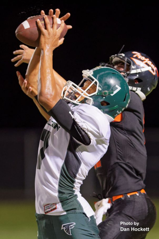 Photo by Dan Hockett West Burlington – Notre Dame Wide Receiver Rel Greer (7) catches a clutch pass to set up a touchdown in the fourth quarter against Fairfield Friday night in Fairfield. West Burlington – Notre Dame defeated Fairfield, 20-13.