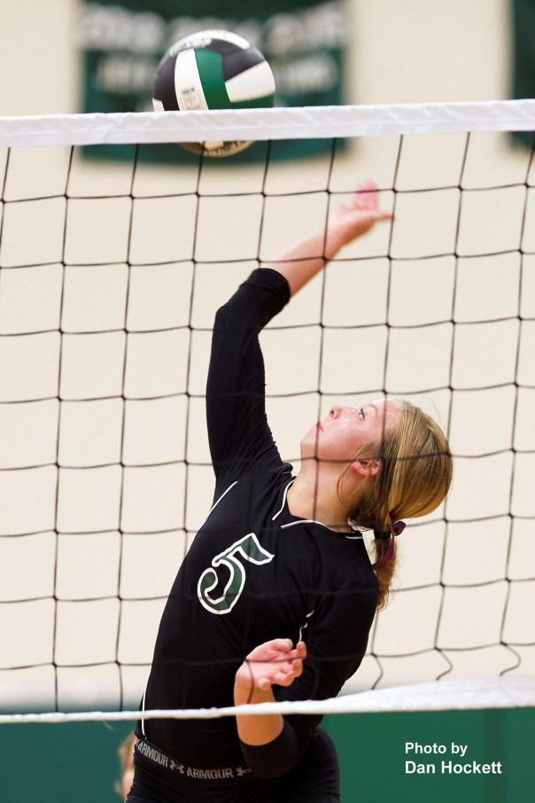 Photo by Dan Hockett West Burlington's Kamaryn Atwater (5) sends the ball over the net against New London Tuesday night in West Burlington. New London defeated West Burlington, 25-22, 25-15, 25-23.