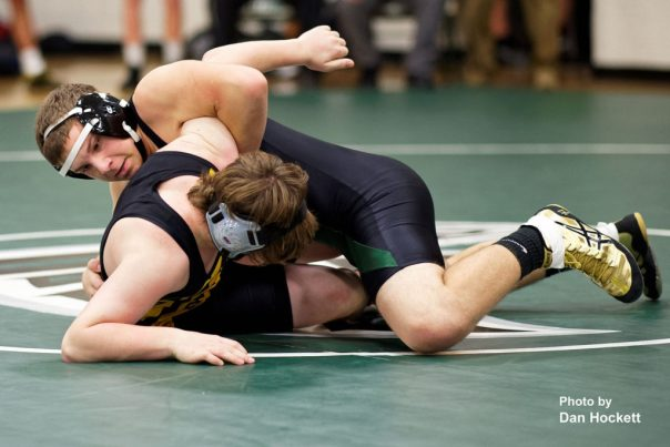 Photo by Dan Hockett Falcon 160-pounder Eli Collier (top) grapples with New London's Cameron Raines (bottom) Thursday night in West Burlington. Raines pinned Collier (2:11). New London defeated WBNDD, 68-6.