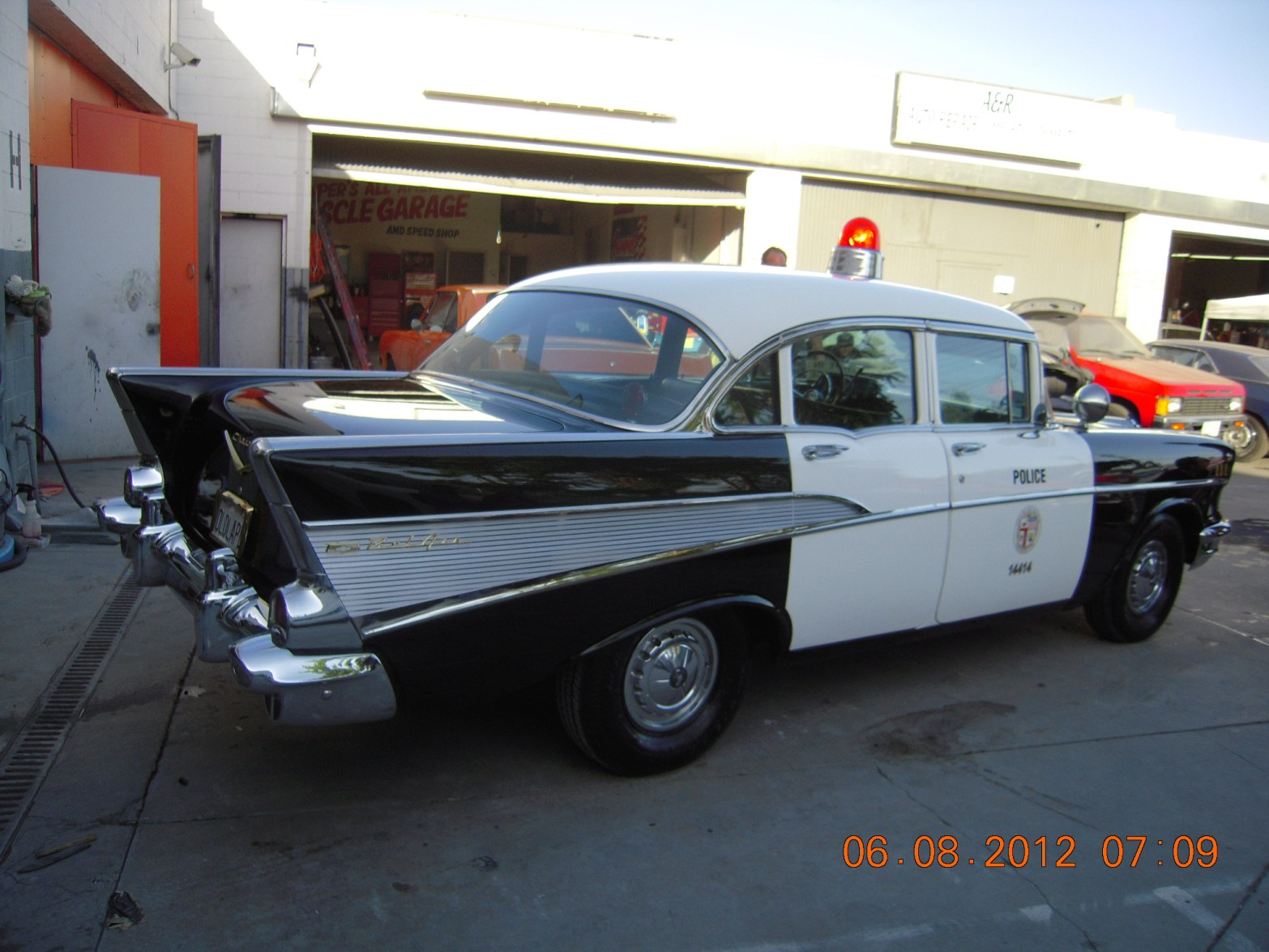 west-coast-body-and-paint-black-bellair-police-car-19