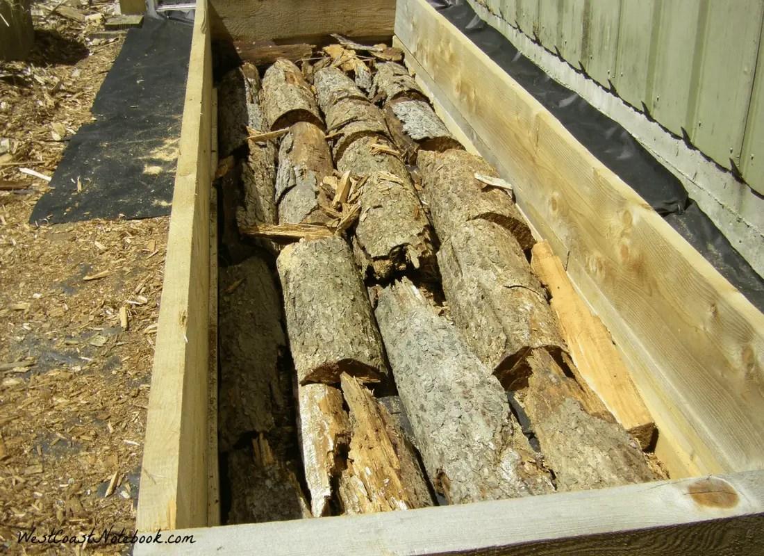 hugelkultur in a raised garden bed