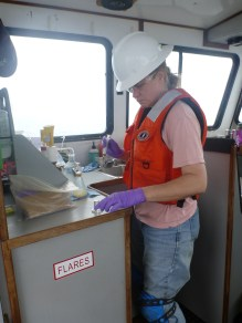 Kathy Hough, OCNMS Marine Technician, 'fixing' (i.e. preserving) seawater samples collected from the near-shore waters along the coast of Olympic National Park. Photo Credit: Lieutenant JG Alisha Friel, OCNMS/NOAA Corps.