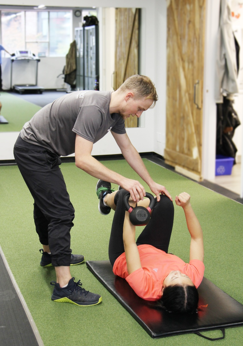 physiotherapist assisting with therapeutic exercise