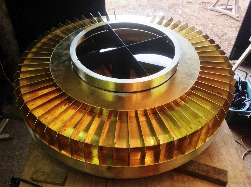Fabrication of a top for a brass lift shaft.
