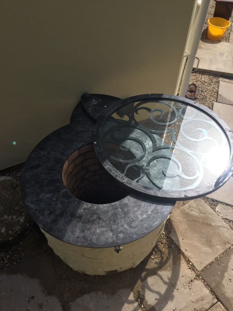 Bespoke pivoting well cover bespoke designed and made by West Country Blacksmiths
