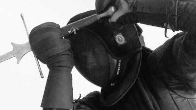 HEMA fighter in sparring kit (cropped)