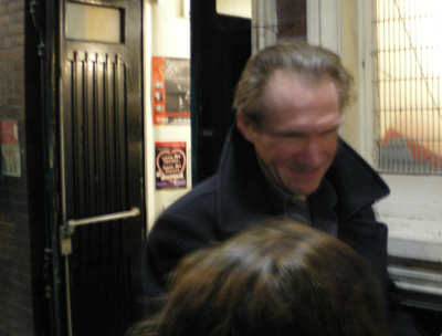 Ralph Fiennes signs a couple of autographs