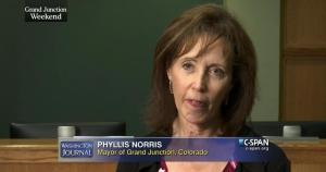 Violations of the law mandating separation of church and state continued under Grand Junction Mayor Phyllis Norris, throughout 2014 and 2015