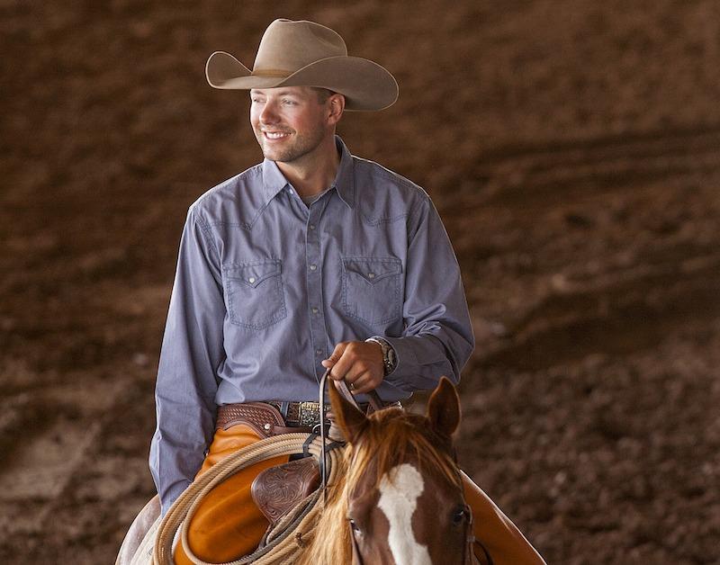 Ben Baldus smiling on horseback in arena