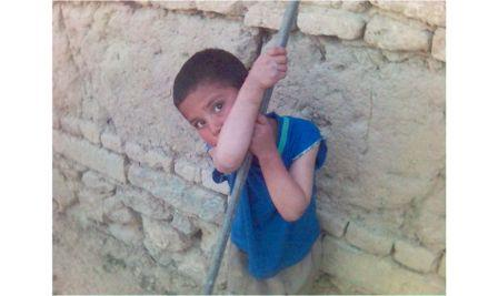 A child outside of the orphanage centre in Paghman.