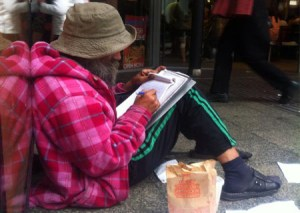 Sam sketches outside Hungry Jack's