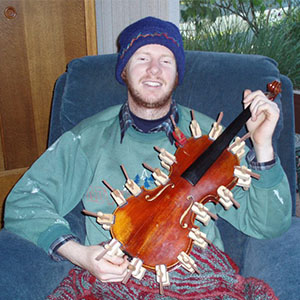 Violinmaker Joel Sheard (featured) fixing his great, great grandfather's violin in late 2007.