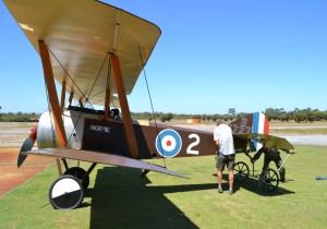 Filippi and Felton wheel the aeroplane out.