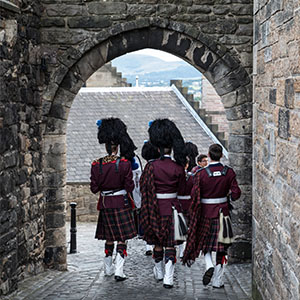 The Scotch pipers march through the streets of Edinburgh.