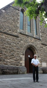 Father Peter Bianchini stands in front of Sacred Heart Church in Highgate. Photo: Gareth Thomas