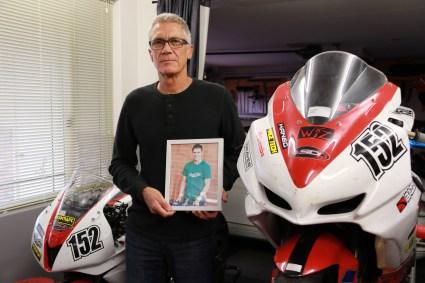 Scott Elliott with a photo of his son, Cameron. Photo: Sheridan New.