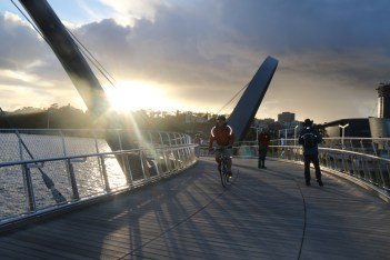 The sun sets over the Elizabeth Quay footbridge