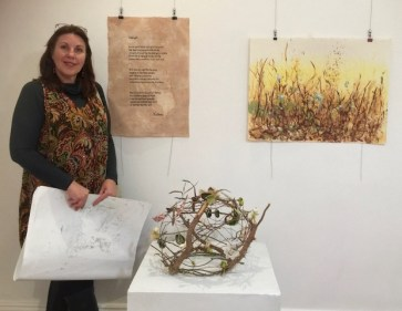 Janeen Cameron in front of her artwork