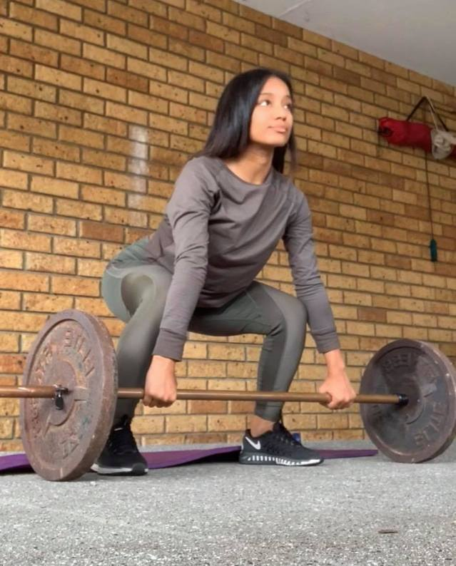 Rose lifting weights at home. Photo supplied.