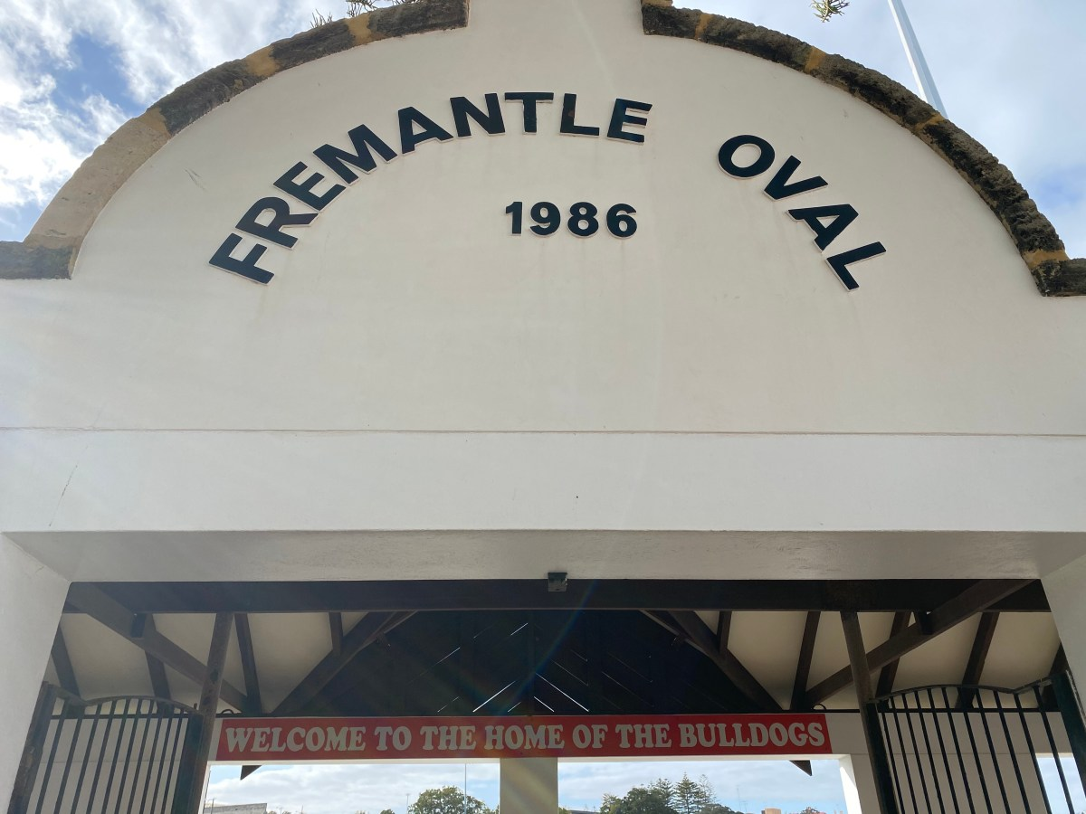 """A photo of the Fremantle Oval entrance gate, which also says """"Welcome to the home of the Bulldogs""""."""