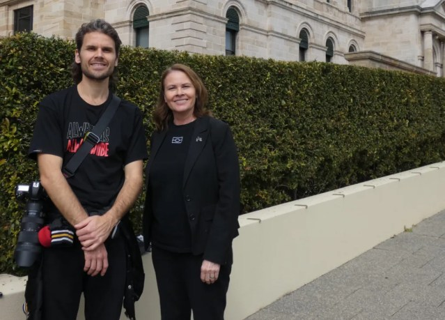 Kim Farmer and Cole Baxter pose in front of WA's Parliament House