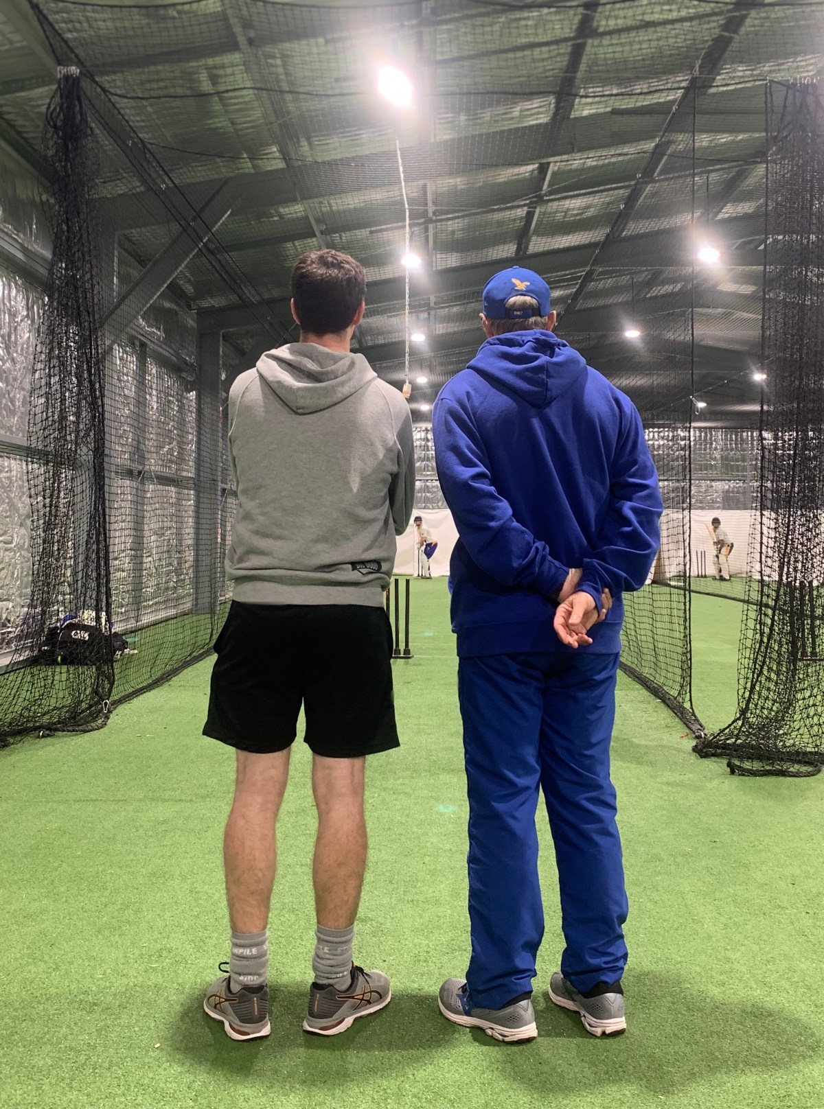 Gosnells Cricket Club head coach Wayne Andrews watches over a training net while talking and checking in with one of his players