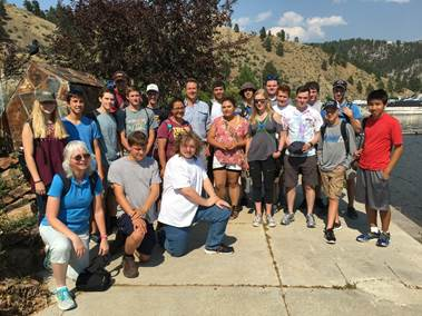 Montana Governor Steve Bullock (center) with STC students at Gates of the Mountain