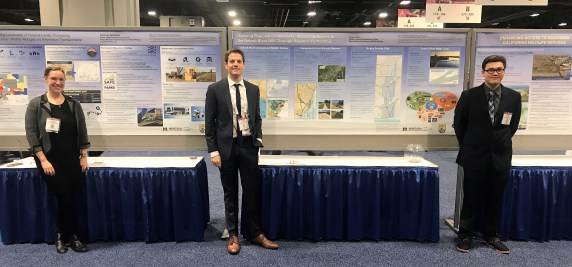 Fellows Corinne Jachelski, Vince Ziols and Dylan Corbin stand in front of their research posters at TRB poster session.