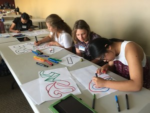 four students participate in design activity at 2018 summer camp