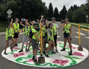 Group of student shows off painted traffic circle project in Bozeman Montana 2019