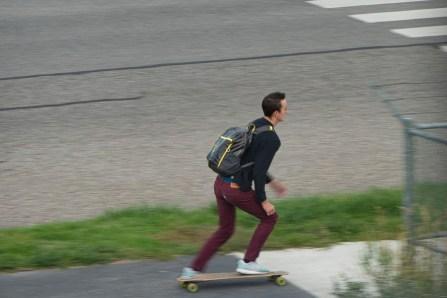 You adult using skateboard on sidewalk
