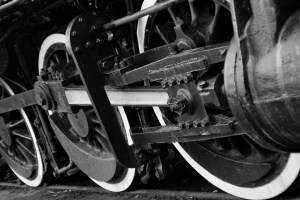 black and white image of train wheels