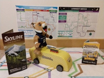 MSU toy mascot rides on a model of a Streamline bus