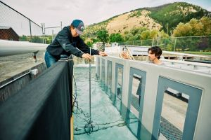 Two students test waterway used for fish research