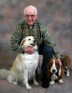 Portrait of Bill Jameson with his two dogs