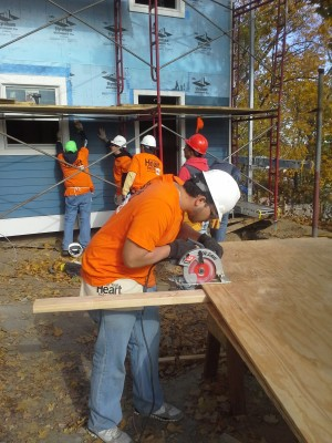 A Habitat for Humanity Westchester volunteer rebuilding a foreclosed home in Yonkers for ownership by military veterans.