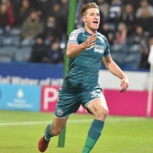 Video Reece Burke scores first Wigan goal against Huddersfield