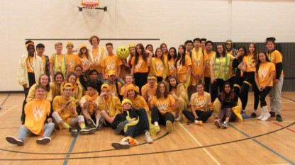 Grade 11 wearing yellow on colour day.