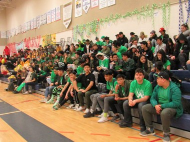 Students ready for games in the gym on colour day.