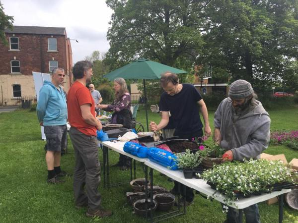 Hanging basket planting in Armley, courtesy Armley Common Right Trust