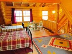 Pentwater Michigan Vacation Rental Cabin loft w rug