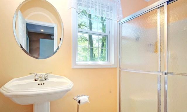 Upper level full bath features a shower