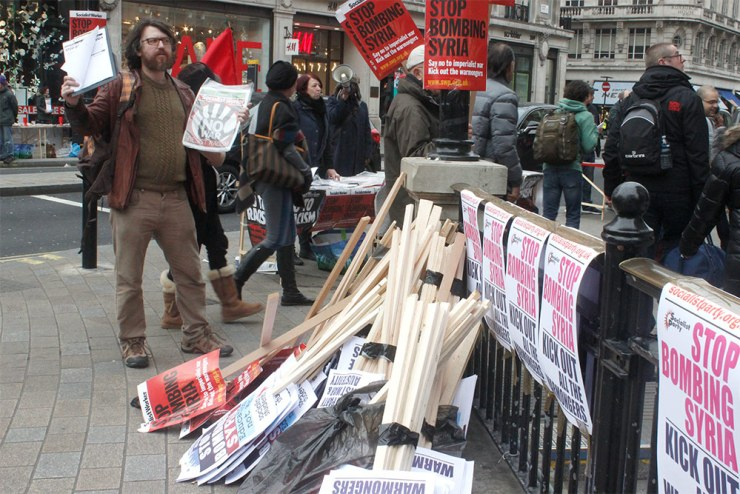 Placards lay on the pavement waiting to be handed over to suppotrs during Saturdays demonstration