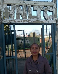 Sonia Winifred at the Tennis Club gate